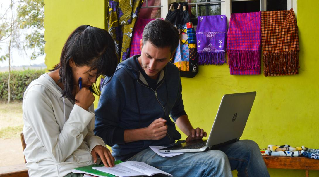 Projects Abroad volunteers enter data into the Global Impact Database while visiting a project.